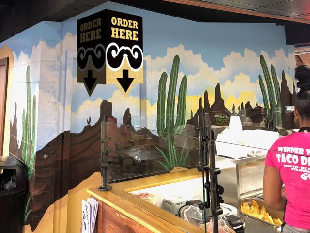 Interior wayfinding signage at Gringos Locos store