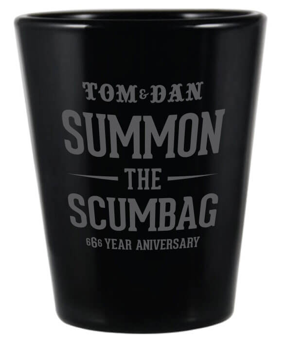 Black shot glass with Summon the Scumbag text